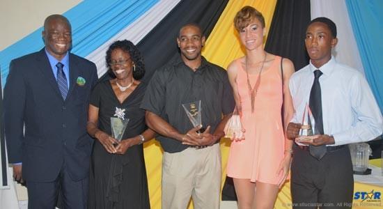From left to right President of the St Lucia Athletics Association, Cornelius Breen; Mrs Spencer who received the Senior Senior Female Athlete award on behalf of daughter Levern Spencer, Senior Male Athlete Albert Reynolds, Junior Female Athlete Jeanelle Scheper and Junior Male Athlete, Mabeq Edgar.
