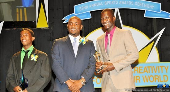 Minister for Youth Development and Sports, Shawn Edward (centre)  with Junior Sportsman of the Year Marbeq Edgar (l) and Sportsman of the Year Darren Sammy.