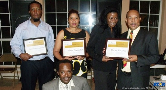 Standing from left: Bertrum Cazaubon, Venus Fournillier, Marna Martinez,  Denis Ishmael.  In front: Thomas Constable accepting awards from the president (Denis Ishmael).