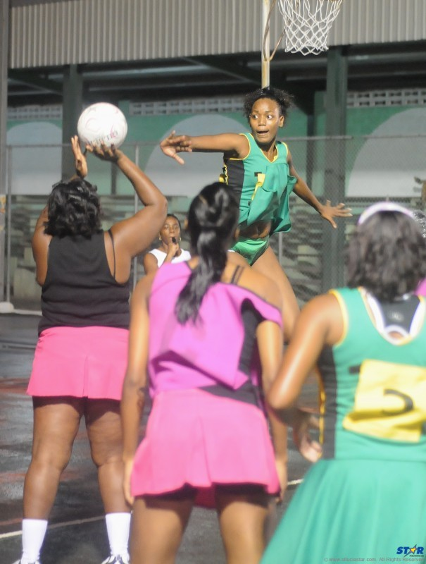 Samantha Mann (centre) of Shamrock A on the defence against Dynamic Fresh Ones in Thursday's final at the Vigie Multi-Purpose Sports Complex.