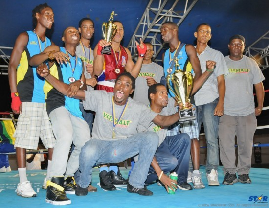An over exuberant Arthur Langilier (front and centre) and Head Coach Conrad Fredericks (beside him) along with members of St Lucia's winning OECS boxing team.