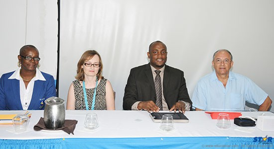 From left to right the head table at the opening of the 2013-2016 Olympic Solidarity Quadrennial Plan Regional Forum: President of the St Lucia Olympic Committee Fortuna Belrose; Head of National Olympic Committee Management Programs, Joanna Zipser-Graves; Minister for Youth Development and Sports, Shawn Edward; and Immediate Past President of the St Lucia Olympic Committee, Richard Peterkin.