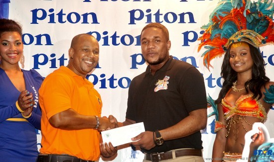 Just 4 Fun's Veil Tobierre (l) receives sponsorship for the carnival band from Piton Brand Manager Rohan Lovence.