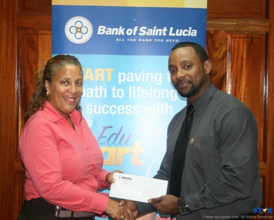 Omari Frederick of BOSL makes presentation to Grow Well Rep Tracey Warner Arnold.