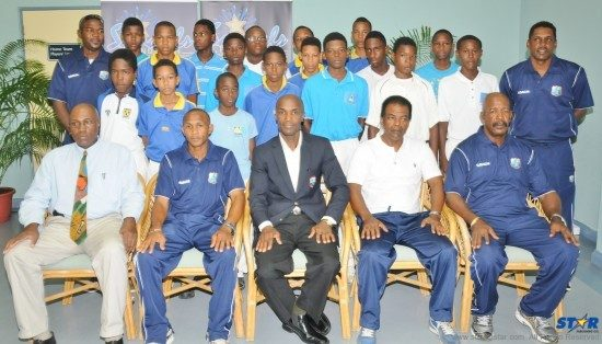 Officials and coaches with cricketers taking part in the 2013 Regional Under-15 High Performance Cricket Camp at the Beausejour Cricket Ground.