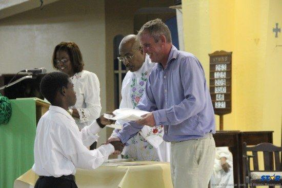 Fr Linus Clovis (centre) and Nicholas Gale reward young Gregorian chant workshop participant.