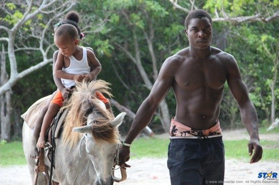 A couple of the little ones enjoying a horseback ride.