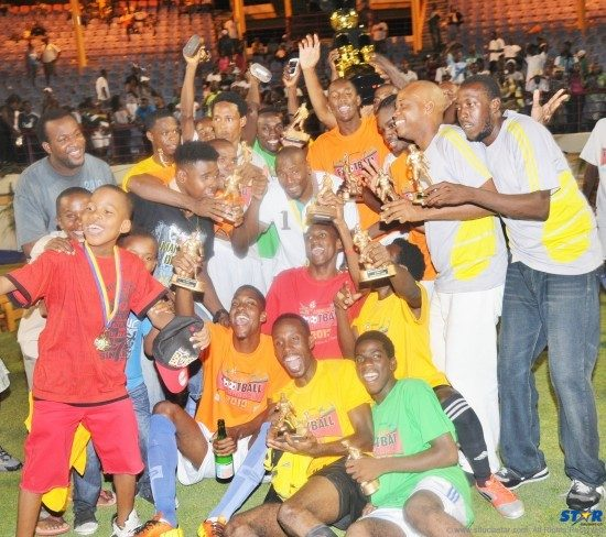 The Gros-Islet team celebrated with their fans after capturing their first ever 2013 Blackheart Knockout Football Tournament title.