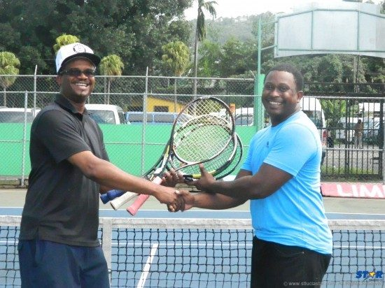 US Based coach Glendon Nicholas (l) presents new equipment to Tiger Tennis Director Sirsean Arlain.