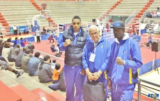 Past President of the St Lucia Amateur Boxing Association Joseph 'Reds' Perreira (center) with heavyweight Ryan Charles (l) and Lyndell Marcellin at the venue of the AMBC Elite Continental Boxing Championships in Chile.
