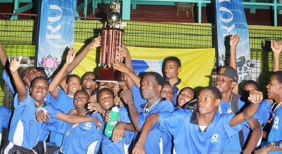 Central Castries players celebrating after winning the Royal Club Under-20 Football title.