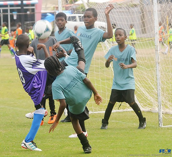 Under 13 action around the Lancers FC goal during a game against Roseau.