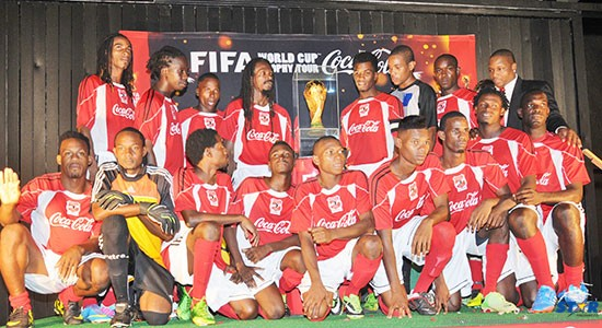 The Coca All stars photographed with the FIFA World Cup Trophy after defeating Gros Islet in a sudden death penalty shootout.