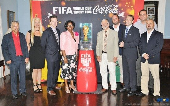 Her Excellency, Governor General, Dame Pearlette Louisy (fourth from left) with FIFA and  Coca-Cola officials, family members, and staff of Du Boulay's Bottling Company Limited.
