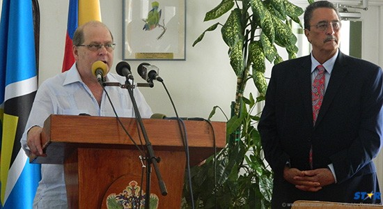 Secretary General of ALBA Petrocaribe Mr Bernardo Alvarez with  PM Kenny Anthony.
