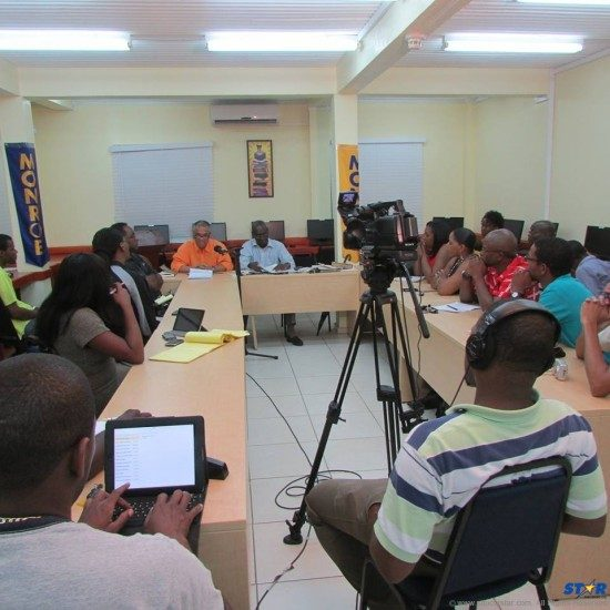 In the aftermath of Timothy Poleon's  legal battle with justice minister Philip LaCorbinere and other government officials, local journalists (center) regrouped on Wednesday to discuss  media law and other matters directly related to the topic du jour.