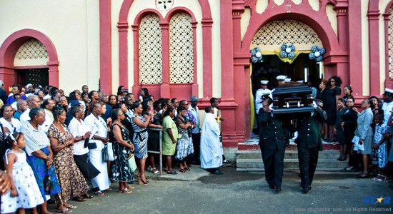 Offical Funeral: Louis George's casket is borne away from the  Catholic Church at Micoud.