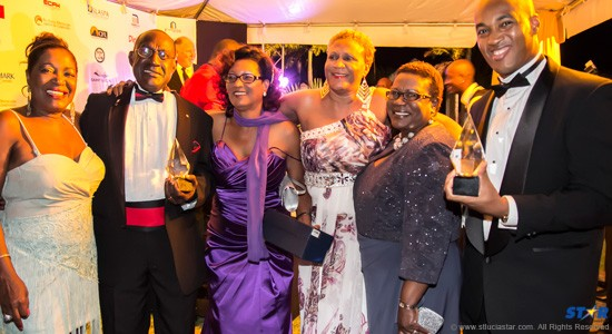 In winners row Berthia Parle of Bay Gardens (l) with Chester Hinkson (second from left) and the rest of the management team of Bay Gardens.