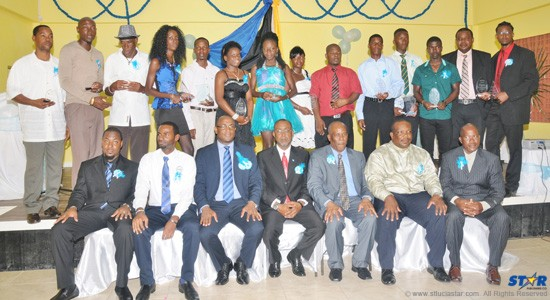 Minister of Youth Development and Sports Shawn Edward (seated third from the left) followed by President of the Senate Claudius Francis with other officials and award recipients.
