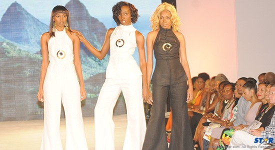 Chef Nina admires Kuumba Designs' linen eveningwear from the front row.