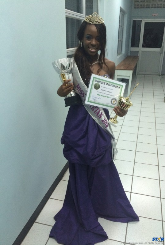 Spartan Queen Doose in her evening gown  stands proud with her first place trophy and  award for Best Interview.
