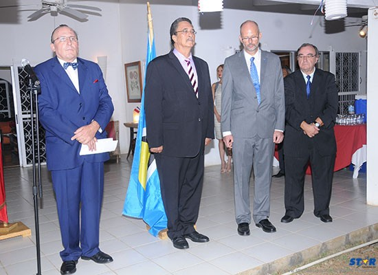 Left to right: Ambassador Eric de la Moussaye, Prime Minister Kenny Anthony, EU delegate Michael Balfour, and Premier Conseiller Gérard Billet during the French national anthem.