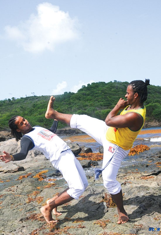 Augustin (top), demonstrates one of the basic offensive moves while Sankar defends.