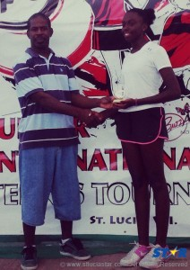 Meggan receiving her trophy from Mr. Girard of the St Lucia Tennis Association.
