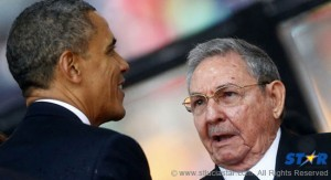 Cuban President Raúl Castro introduces himself to his U.S. counterpart, Barack Obama, in South Africa in December, 2013. The two men actually shake hands.
