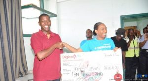 James Lewis (left) receiving his cheque from a Digicel team member.