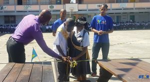CFL Managing Director helps students to cut ribbon.
