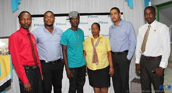 Left to Right: Jimmy Clavier of the CDF, Rohan Lovence Piton Brand Manager, performer Mongstar, Dreina Frederick of the CDF, Thomas Leonce marketing manager WLBL, Tyrone Harris of the CDF.