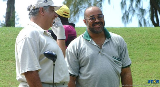Dr. Didacus Jules (right) at Cap Estate golf course with billionaire businessman Gilbert Chagoury at the time of Bill Clinton's visit to Saint Lucia. Jules was then Mario Michel's permanent secretary at the education ministry and an ardent promoter of the controversial Lebanese-Nigerian.