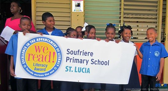 Soufriere Primary School Students tout reading.