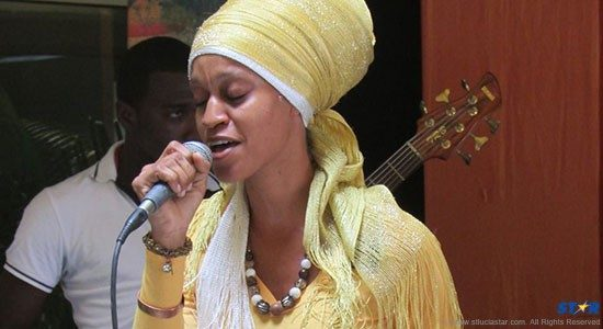 Empress Ila performing with Emerson Nurse & Friends at Blue Coral Mall on Monday.