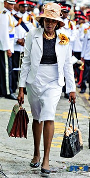 Gros Islet MP and commerce minister Emma Hippolyte on her way to the April 29 parliamentary session—doubtless with Lambirds on her mind!