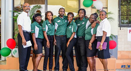 Management and staff of the newly rebranded Jn Marie and Sons Rubis Service Station.