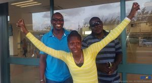 Gaius Harry (brand Manger) Dwaine Talbert and Melissa Talbert at the Hewanorra International Airport shortly before departure on Wednesday.