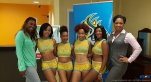 Sue Monplaisir of CPL Saint Lucia (left) and Britney Jongue of Courts (right) with the CPL Cheerleaders.