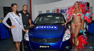 Miss Piton Anya Edwin, Rohan Lovence Piton Brand Manager, and a Piton Carnival brand ambassador unveil carnival giveaway.