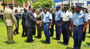 Inspecting the guard: prime minister Kenny Anthony (with Philip J Pierre and  Philip La Corbiniere in background) congratulates officers.