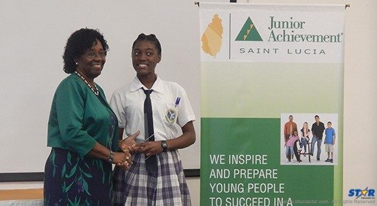 Governor General Dame Pearlette Louisy presenting Gem Papier of George Charles Secondary School  with an award.