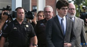 Owen Labrie is swarmed by the media as he leaves the courtroom this week.