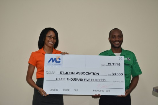 Ms. Fern Wilson, Marketing Coordinator, M&C Group of Companies presenting a cheque to Mr. Glen Wilson Chief Commissioner of St. John Saint Lucia.