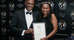 Lynton and Eroline Lamontagne proudly display the award given to Fond Doux at the World Boutique Hotel Awards.