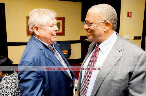 Minister of Finance and Planning Dr Peter Phillips (right) and Sandals Resorts and Jamaica Observer Chairman Gordon 'Butch' Stewart at a news luncheon at the Observer's Berechwood Avenue, Kingston, headquarters. (PHOTO: JOSEPH WELLINGTON)