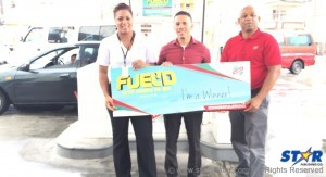 Left-right: Britney Jongue - Courts OECS PRO, Lorne Charles - winner of Courts prize and a RUBIS representative.