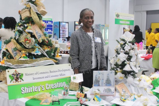 Shirley Edward with her pieces at the recent Saint Lucia/Taiwan trade exhibition.