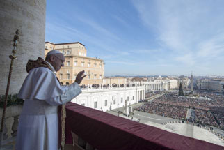 "Pope Francis waves during the ""Urbi et Orbi"" (to the City and the World) Christmas message from the balcony overlooking St. Peter's Square at the Vatican on December 25, 2015. (Reuters/Osservatore Romano)"