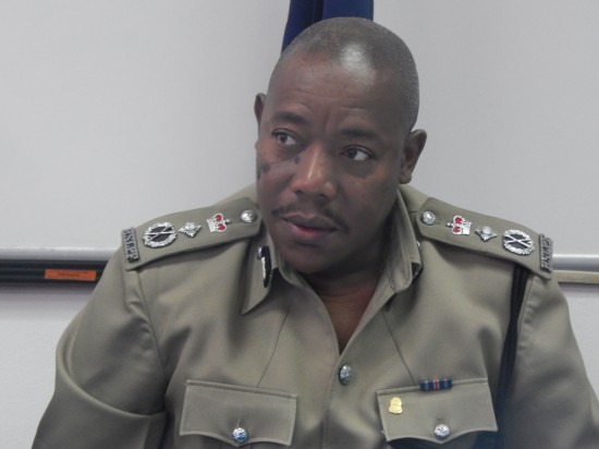 Acting Police Commissioner Errol Alexander delivering a review of 2015 on Friday at a press conference.
